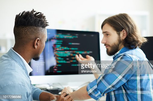 Meeting of programmers : Stock Photo