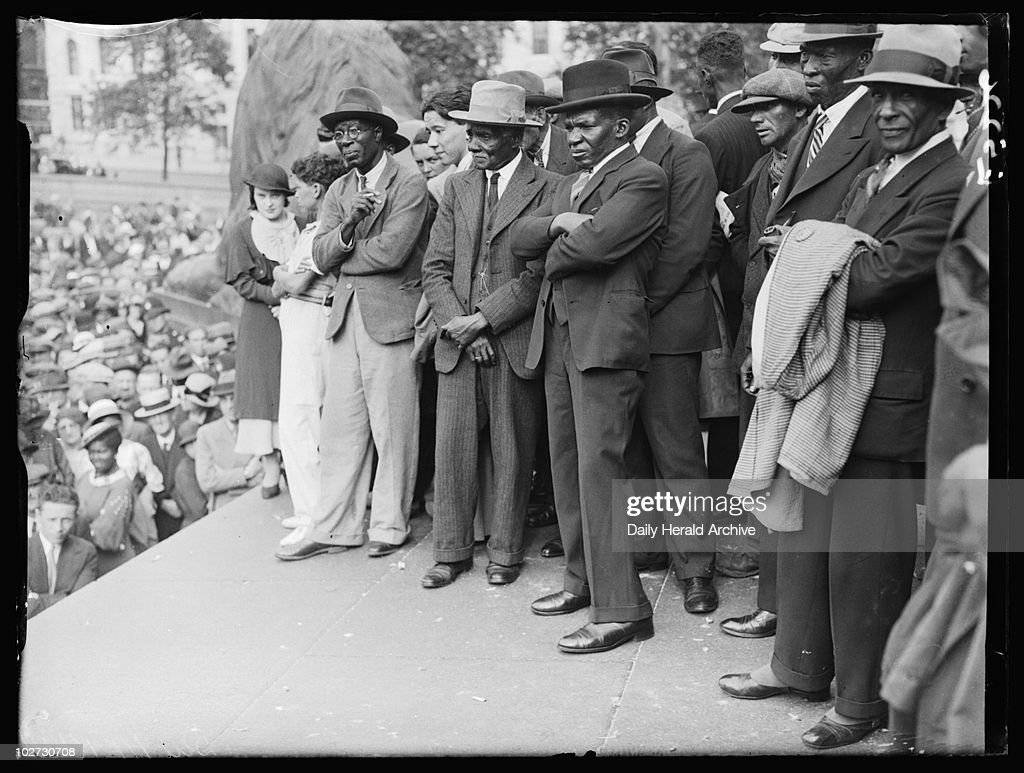 Meeting of the International African Friends of Ethiopia, London, 1935, A photograph of people on the platform at a meeting of the International African Friends of Ethiopia in Trafalgar Square, taken by Tomlin for the Daily Herald newspaper on 25 August, 1935. Tensions were rising as Italy threatened to invade Ethiopia. Ignoring international pressure, Italy attacked in October 1935. Soldiers entered the Ethiopian capital, Addis Ababa, in May 1936. Ethiopia was liberated in 1941, during World War Two. This photograph has been selected from the Daily Herald Archive, a collection of over three million photographs. The archive holds work of international, national and local importance by both staff and agency photographers.