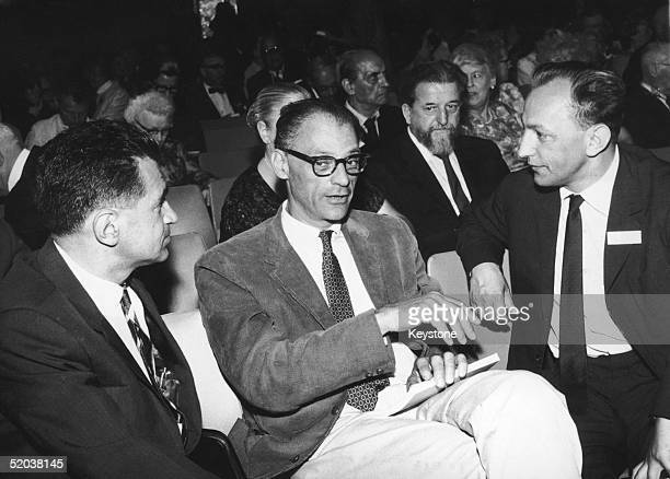 A meeting of the International PEN Club at Bled in Slovenia circa 1955 Yugoslavian writers Erih Kos and Miodrag Bulatovic in conversation with US...