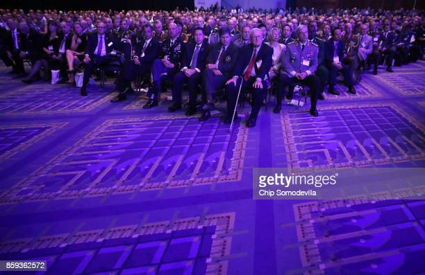 Meeting participants listen to US Defense Secretary James Mattis deliver the keynote address during the Association of the United States Army's...