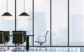 Meeting room in modern office 3D rendering image.There are white floor.Furnished with black furniture .There are large windows look out to see the city background in the  fog