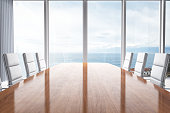 Empty contemporary office meeting room interior design with beautiful view of the clouds and sea.