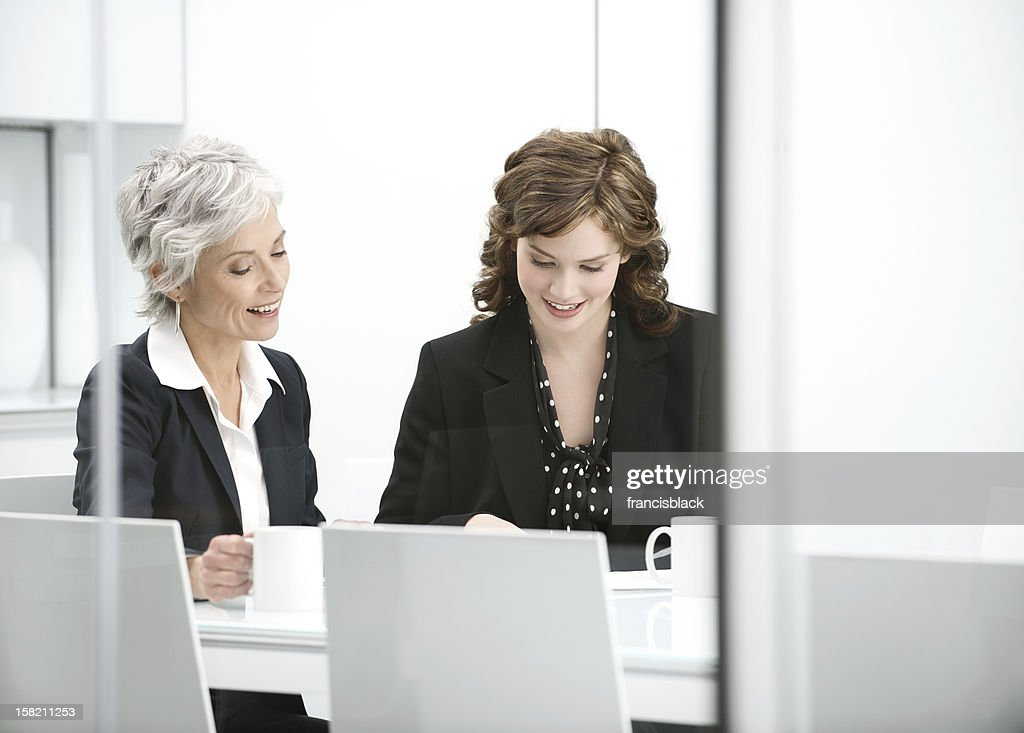 Incontro con donna d'affari matura : Stock Photo