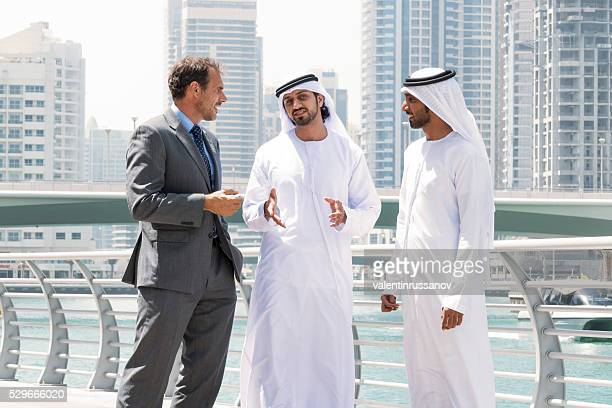 Meeting with Middle eastern businessmen and western man