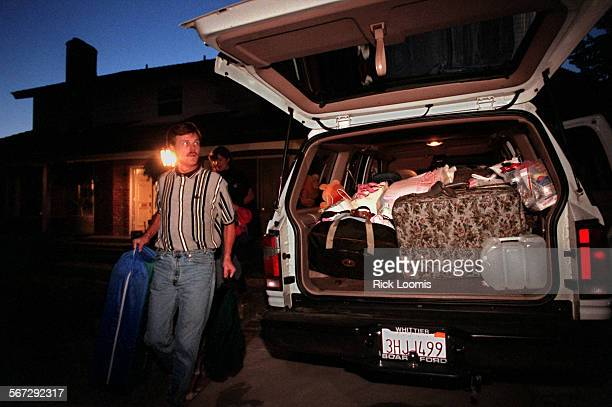MEevacuate0416RL––Anaheim––Pat Patterson loads his belongings into his vehicle after he and his family were strongly advised to leave what he calls...
