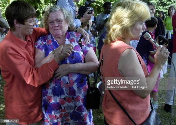 Meg Colpitts from Newcastle and founder of Justice for Children comforts Winnie Johnson who broke down in tears at a rally organised by Dee Warner...