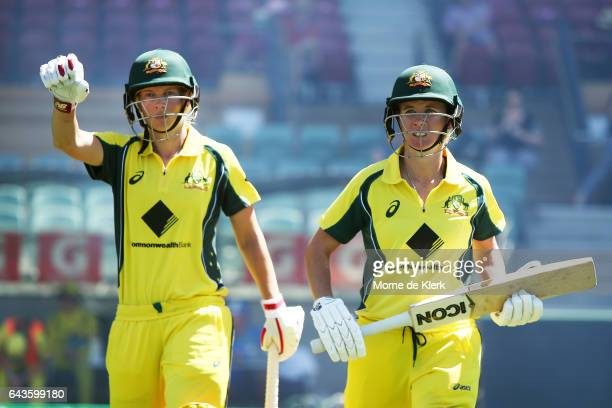 Meg Lanning and Beth Mooney of Australia walks out to bat during the Women's Twenty20 International match between the Australia Southern Stars and...