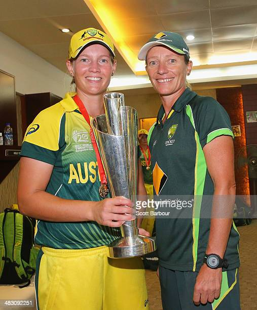 Meg Lanning captain of Australia and Cathryn Fitzpatrick coach of Australia pose with the trophy in the changing rooms after winning the Final of the...