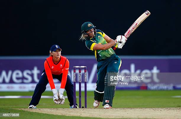 Meg Lanning of Australia hits to the on side as wicketkeeper Sarah Taylor of England watches on during the 1st Natwest T20 of the Women's Ashes...