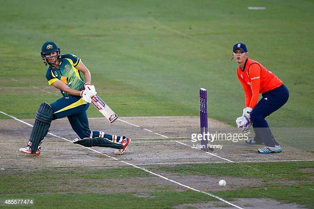 Meg Lanning of Australia plays a shot to the on side as wicketkeeper Sarah Taylor of England watches on during the 2nd NatWest T20 of the Women's...