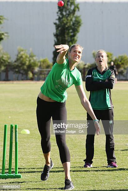 Meg Lanning of the Melbourne Stars as Caitlin Bassett of the Diamonds has a go at bowling during the Women's Big Bash League Launch at Toorak Prahan...