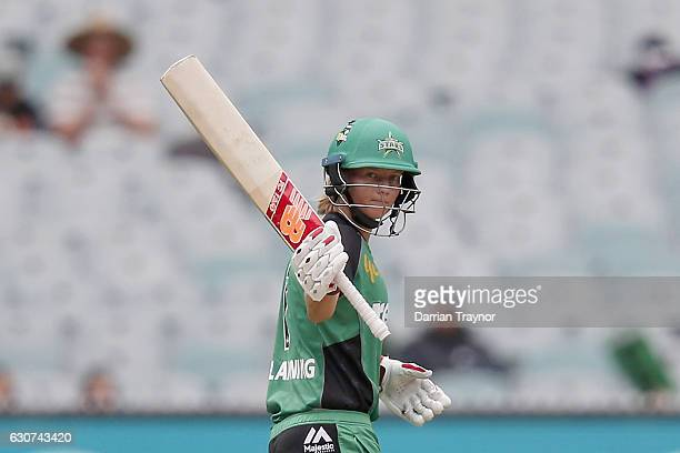 Meg Lanning of the Melbourne Stars raises his bat after scoring 50 runs during the WBBL match between the Stars and Renegades at the Melbourne...