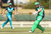 Meg Lanning of the Stars hits the ball during the Women's Big Bash League match between the Melbourne Stars and the Brisbane Heat at Junction Oval on...