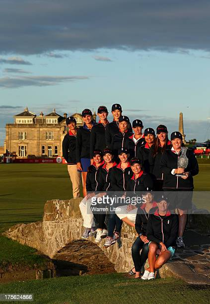 Meg Mallon the USA Captain poses with her team and the trophy on the Swilcan Bridge following the announcement of the 2013 Solheim Cup Europe and USA...