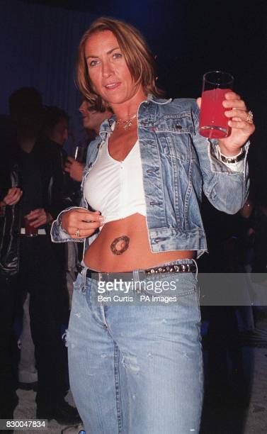 Meg Mathews wife of Oasis guitarist Noel Gallagher shows off a tattoo transfer at the launch tonight of a new range of L'Oreal Hair and Body Wear The...