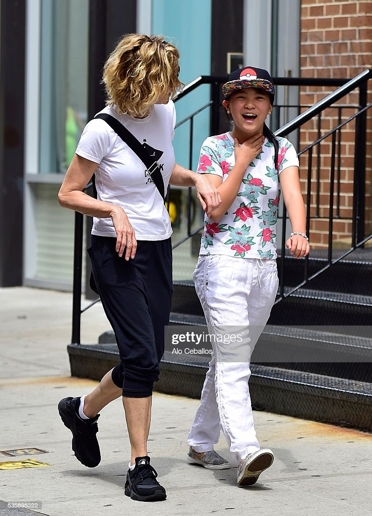<a gi-track='captionPersonalityLinkClicked' href=/galleries/search?phrase=Meg+Ryan&family=editorial&specificpeople=203107 ng-click='$event.stopPropagation()'>Meg Ryan</a> and Daisy True Ryan are seen in Soho on May 30, 2016 in New York City.