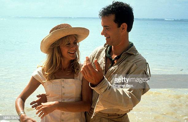 Meg Ryan and Tom Hanks on a beach in a scene from the film 'Joe Versus The Volcano' 1990