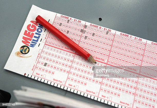 Mega Millions number selection card lies on the counter at a lottery ticket kiosk at O'Hare International Airport in Chicago Illinois US on Friday...