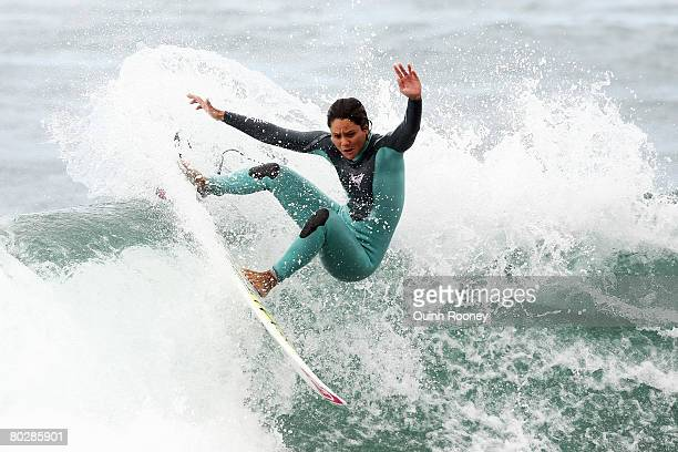 Megan Abubo of Hawaii has a warmup surf as the contest is put on hold due to poor swell during the Rip Curl Pro as part of the ASP World Tour held at...