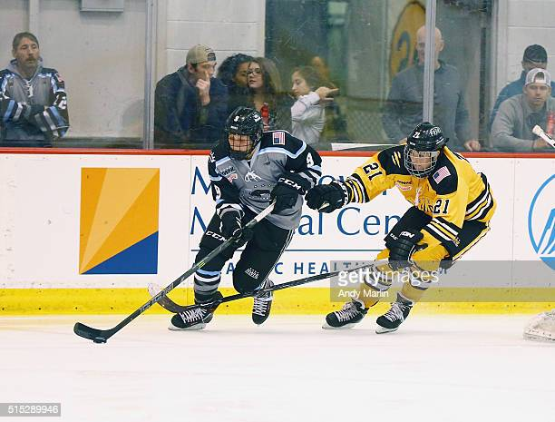 Megan Bozek of the Buffalo Beauts plays the puck while being defended by Hilary Knight ofBoston Pride during Game 2 of the league's inaugural...
