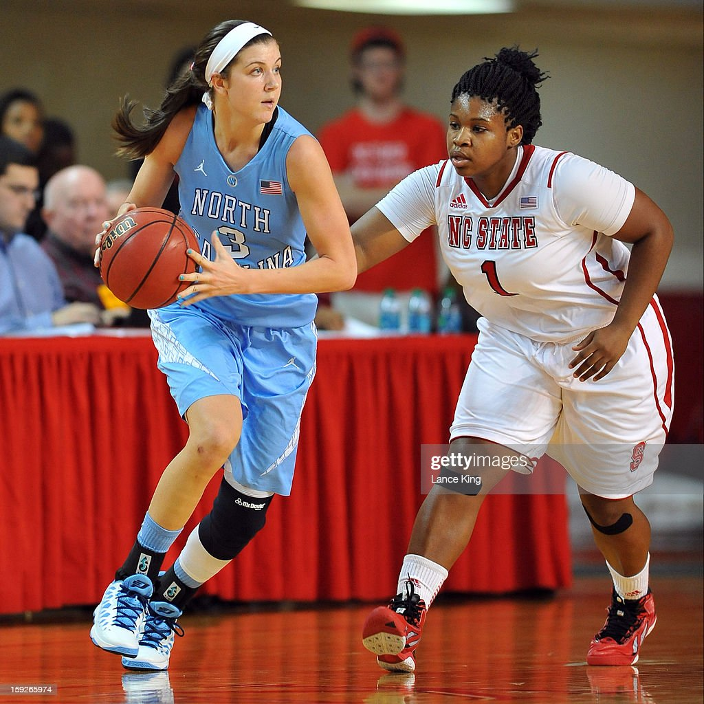Megan Buckland #3 of the North Carolina Tar Heels dribbles against Myisha Goodwin-Coleman #1 of the North Carolina State Wolfpack at Reynolds Coliseum on January 10, 2013 in Raleigh, North Carolina. North Carolina defeated NC State 70-66.