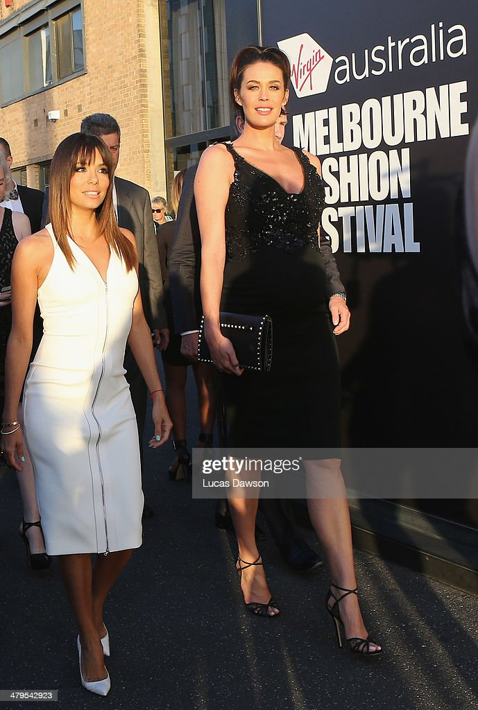<a gi-track='captionPersonalityLinkClicked' href=/galleries/search?phrase=Megan+Gale&family=editorial&specificpeople=202042 ng-click='$event.stopPropagation()'>Megan Gale</a> and <a gi-track='captionPersonalityLinkClicked' href=/galleries/search?phrase=Eva+Longoria&family=editorial&specificpeople=202082 ng-click='$event.stopPropagation()'>Eva Longoria</a> arrive before the Camilla Show during Melbourne Fashion Festival on March 19, 2014 in Melbourne, Australia.