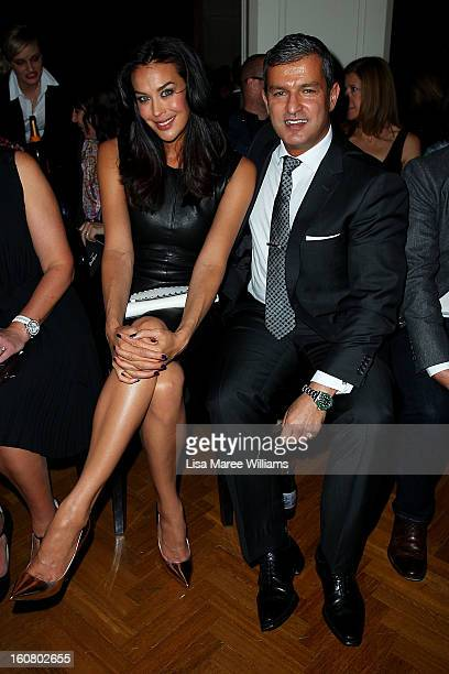 Megan Gale and Paul Zahra sit in the front row at the David Jones A/W 2013 Season Launch at David Jones Castlereagh Street on February 6 2013 in...