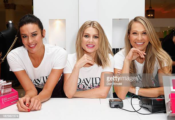 Megan Gale Natalie Bassingthwaighte and Erika Heynatz pose at David Jones Shop Pink Donation Day 2013 for Breast Cancer Awareness Month on October 3...