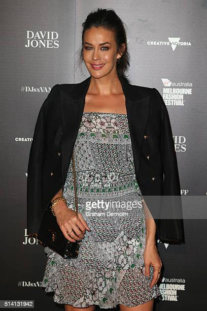 Megan Gale poses as she arrives for the David Jones opening event as part of Virgin Australia Melbourne Fashion Festival on March 7 2016 in Melbourne...