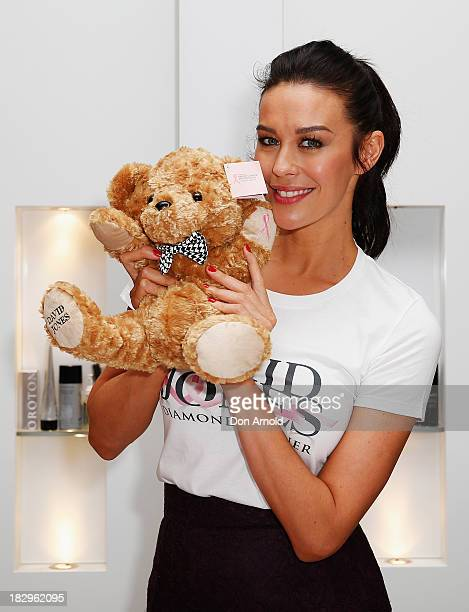 Megan Gale poses at David Jones Shop Pink Donation Day 2013 for Breast Cancer Awareness Month on October 3 2013 in Sydney Australia