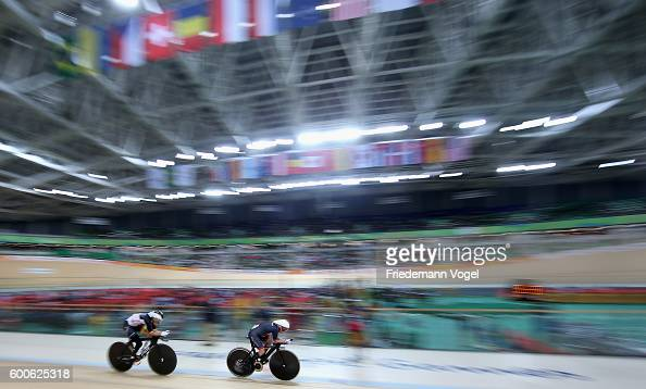 Megan Giglia of Great Britain and Denise Schindler of Germany compete during womens C123 3000m individual pursuit track cycling on day 1 of the Rio...