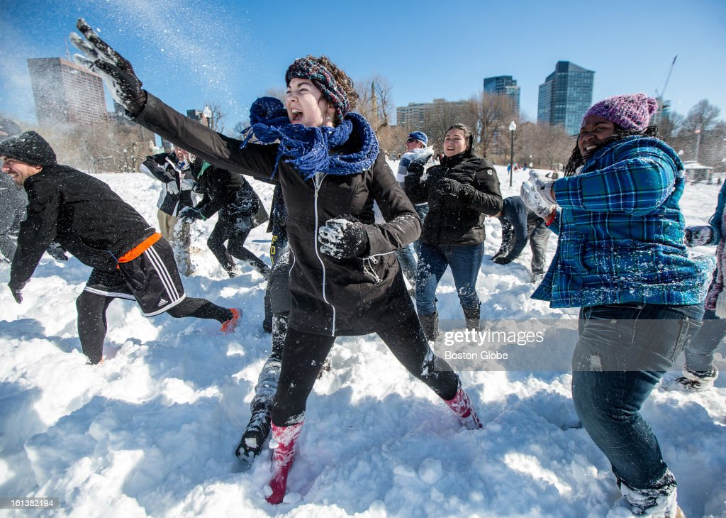 Megan Graves, 18, of Suffolk University, left, hurled a snowball at the opposing side as about 50 people participated in a planned snowball fight on Boston Common after a blizzard dropped over two feet of snow in the area, Sunday, Feb. 10, 2013.