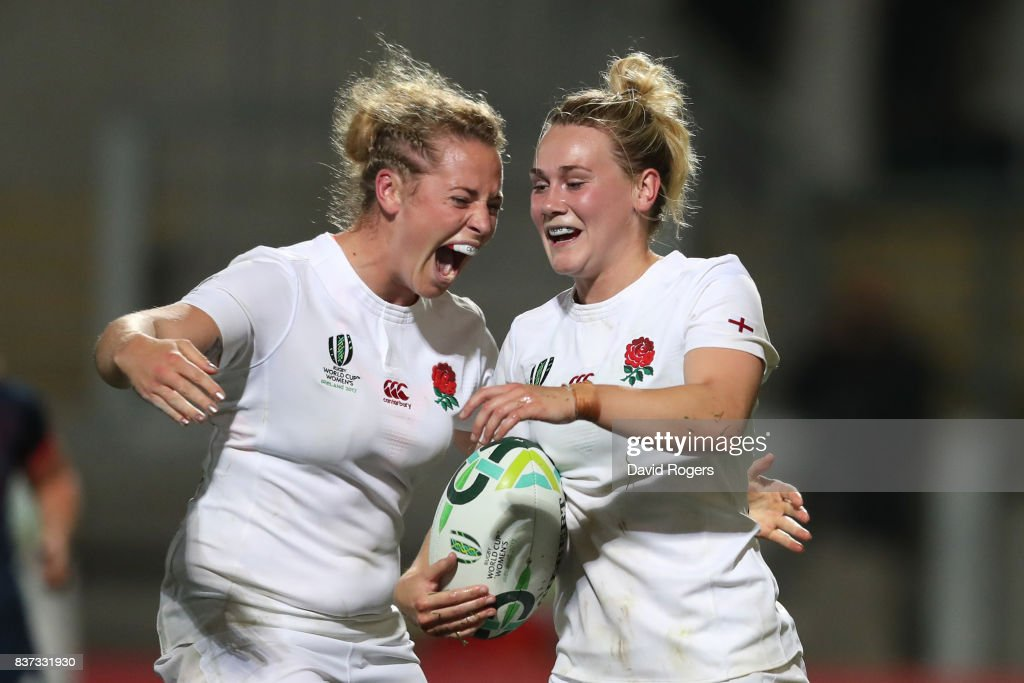 Megan Jones of England celebrates with teammate Amber Reed (L) after scoring her team's second try during the Women's Rugby World Cup 2017 Semi Final match between England and France at the Kingspan Stadium on August 22, 2017 in Belfast, United Kingdom.