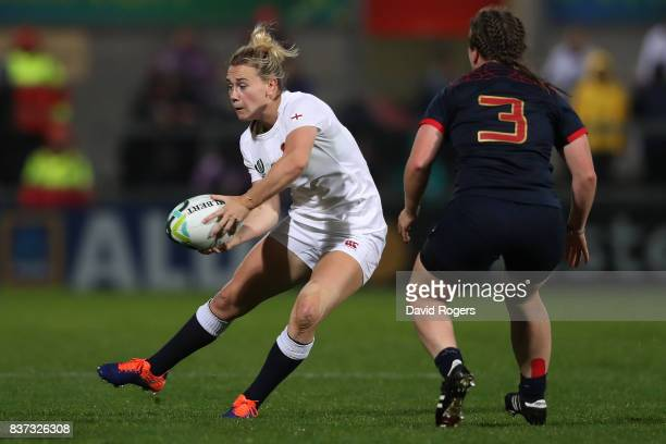 Megan Jones of England passes the ball as Julie Duval of France closes in during the Women's Rugby World Cup 2017 Semi Final match between England...
