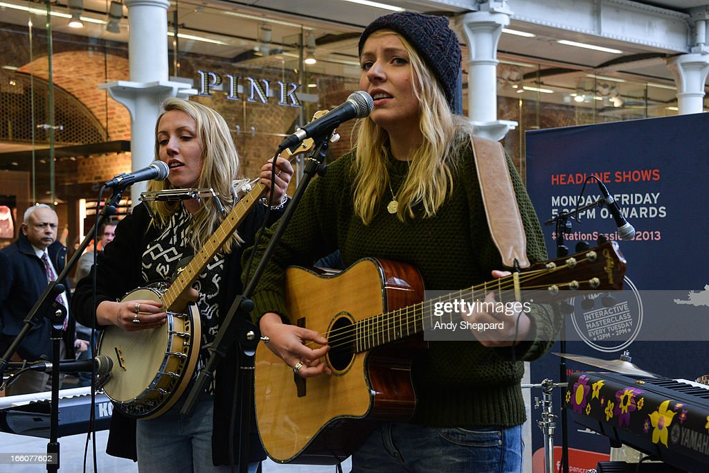 Megan Markwick and Lily Somerville of the band Lily & Meg perform at Station Sessions Festival 2013 at St Pancras Station on April 8, 2013 in London, England.