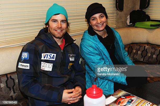 Megan McJames and Nolan Kasper of the USA ski team smile while kids from Munich visit the USA Ski Team's Mobile Nutrition Center near the Kandahar...
