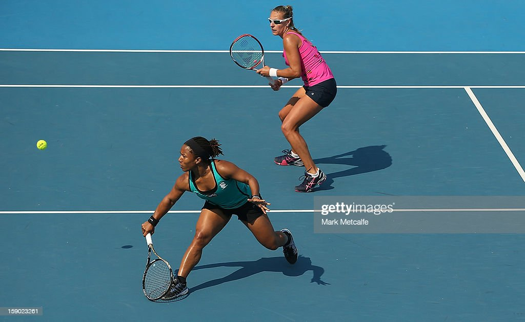 Megan Moulton-Levy of the USA and Liga Dekmeijere of Latvia in action during their first round doubles match against Irina-Camelia Begu and Simona Halep of Romania during day three of the Hobart International at Domain Tennis Centre on January 6, 2013 in Hobart, Australia.