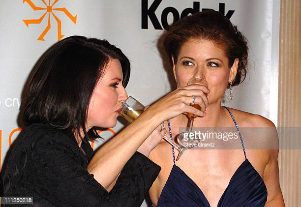 Megan Mullally and Debra Messing during 2005 Women In Film Crystal Lucy Awards Arrivals in Beverly Hills California United States