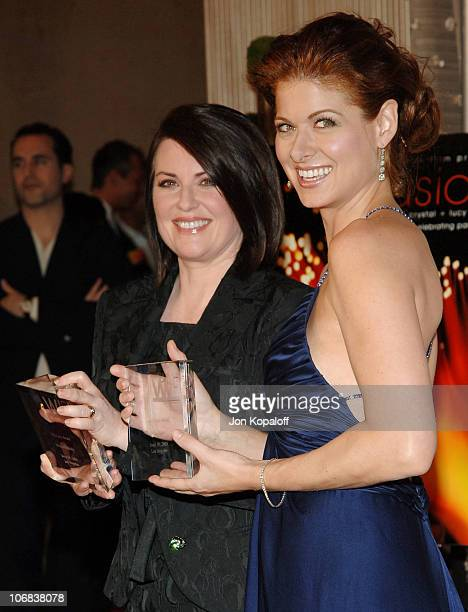 Megan Mullally and Debra Messing during Women in Film Presents Fusion The 2005 Crystal Lucy Awards An Evening Celebrating Partnership at The Beverly...
