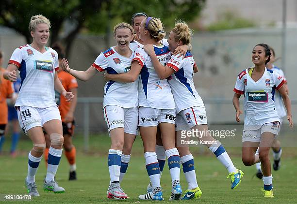 Megan Oyster of the Jets celebrates with her team mates after scoring a goal during the round sevens WLeague match between Brisbane Roar and...
