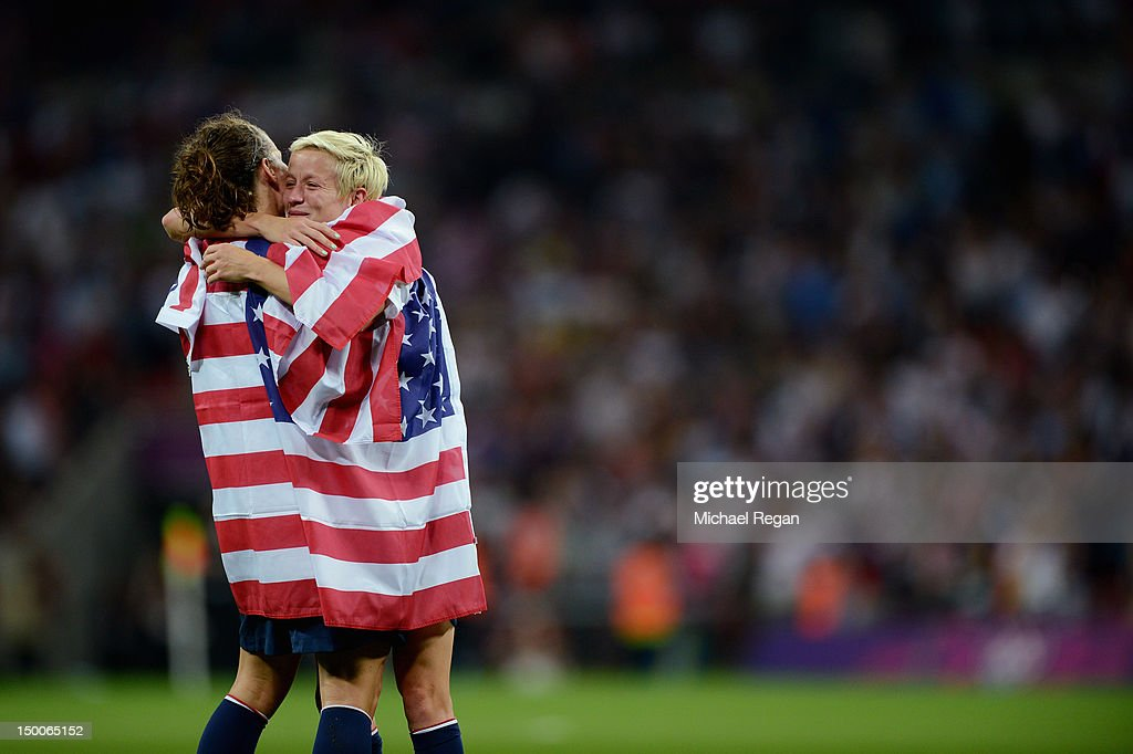 <a gi-track='captionPersonalityLinkClicked' href=/galleries/search?phrase=Megan+Rapinoe&family=editorial&specificpeople=736784 ng-click='$event.stopPropagation()'>Megan Rapinoe</a> #15 and Lauren Cheney #12 of the United States celebrate with the American flag after defeating Japan by a score of 2-1 to win the Women's Football gold medal match on Day 13 of the London 2012 Olympic Games at Wembley Stadium on August 9, 2012 in London, England.