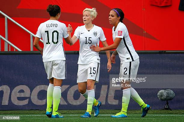 Megan Rapinoe celebrates with Carli Lloyd and Sydney Leroux of United States after Rapinoe scores her second goal against Australia in the second...