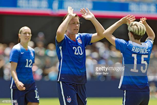 Megan Rapinoe congratulates Abby Wambach of the United States after scoring her second goal against Ireland in the first half of their international...