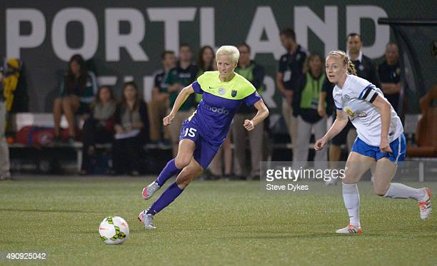 Megan Rapinoe of Seattle Reign FC brings the ball up the pitch during the first half of the game against the FC Kansas City at Providence Park on...