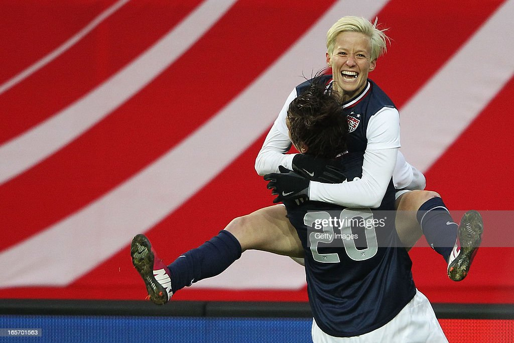 <a gi-track='captionPersonalityLinkClicked' href=/galleries/search?phrase=Megan+Rapinoe&family=editorial&specificpeople=736784 ng-click='$event.stopPropagation()'>Megan Rapinoe</a> of the United States celebrates her team's second goal with <a gi-track='captionPersonalityLinkClicked' href=/galleries/search?phrase=Abby+Wambach&family=editorial&specificpeople=162757 ng-click='$event.stopPropagation()'>Abby Wambach</a> of the United States during the Women's International Friendly match between Germany and the United States at Sparda-Bank-Hessen-Stadion on April 5, 2013 in Offenbach, Germany.