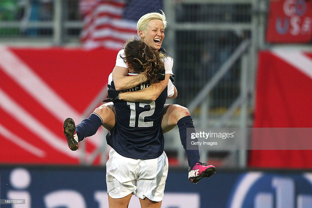 <a gi-track='captionPersonalityLinkClicked' href=/galleries/search?phrase=Megan+Rapinoe&family=editorial&specificpeople=736784 ng-click='$event.stopPropagation()'>Megan Rapinoe</a> (top) of the United States celebrates with team-mate Lauren Cheney after scoring their team's second goal during the Women's International Friendly match between Germany and the United States at Sparda-Bank-Hessen-Stadion on April 5, 2013 in Offenbach, Germany.