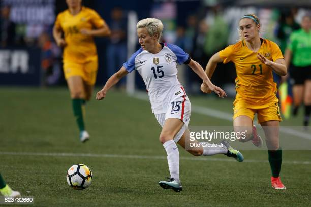 Megan Rapinoe of the United States dribbles against Ellie Carpenter of Australia during the 2017 Tournament of Nations at CenturyLink Field on July...
