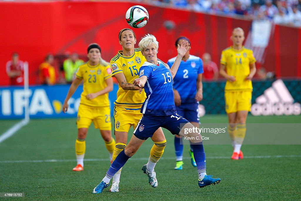 Megan Rapinoe of the United States goes for the ball in front of Therese Sjogran of Sweden in the first half in the FIFA Women's World Cup Canada...