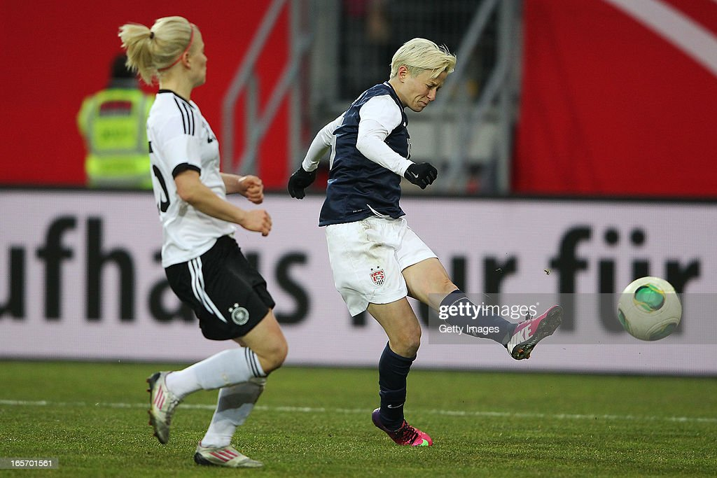 <a gi-track='captionPersonalityLinkClicked' href=/galleries/search?phrase=Megan+Rapinoe&family=editorial&specificpeople=736784 ng-click='$event.stopPropagation()'>Megan Rapinoe</a> of the United States scores her team's second goal against Leonie Maier of Germany during the Women's International Friendly match between Germany and the United States at Sparda-Bank-Hessen-Stadion on April 5, 2013 in Offenbach, Germany.