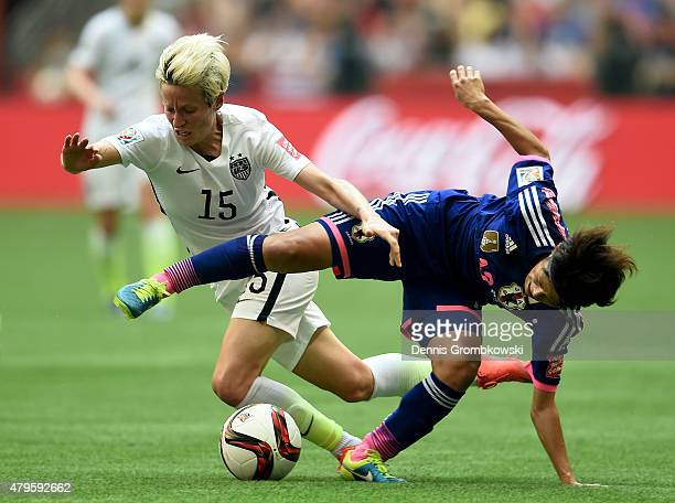 Megan Rapinoe of the United States with the ball against Saori Ariyoshi 19 of Japan in the first half in the FIFA Women's World Cup Canada 2015 Final...